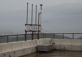 Image: Outdoor IMPROVE aerosol sampler during a gray, rainy day.